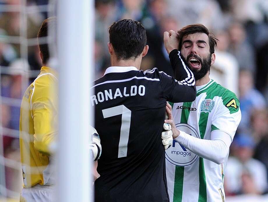 Cristiano Ronaldo strikes Cordoba's Jose Angel Crespo. Photo: CRISTINA QUICLER / AFP / Getty Images / CRISTINA QUICLER
