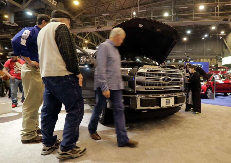 Patrons of the 2015 Houston Auto Show walk around the new 2015 Ford F-150 4x4 Supercrew truck Saturday January 23, 2015 during the 2015 Houston Auto Show at the NRG Center in Houston, Texas. Photo: Billy Smith II, Chronicle / © 2015 Houston Chronicle