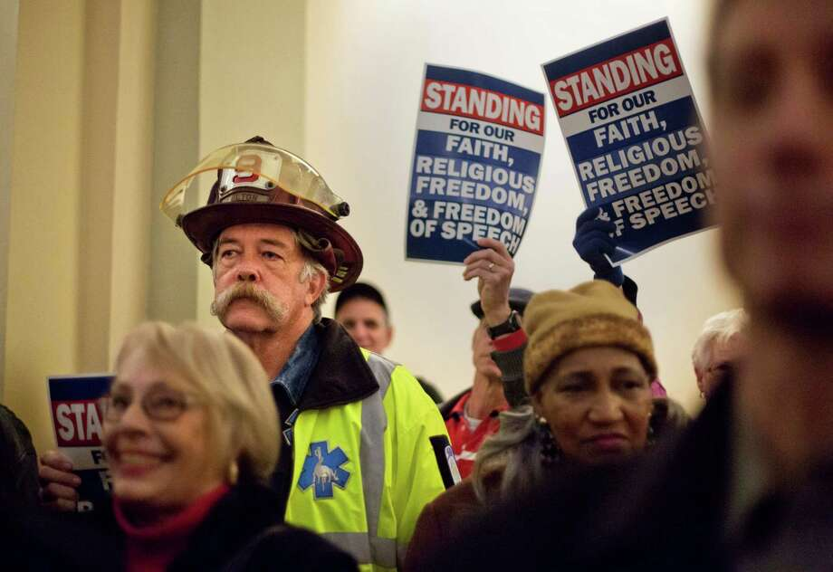 Michael O'Hara, a paramedic, attends a recent rally for former Atlanta Fire Chief Kelvin Cochran, who was fired for his book calling homosexuality a perversion. Photo: David Goldman, STF / AP