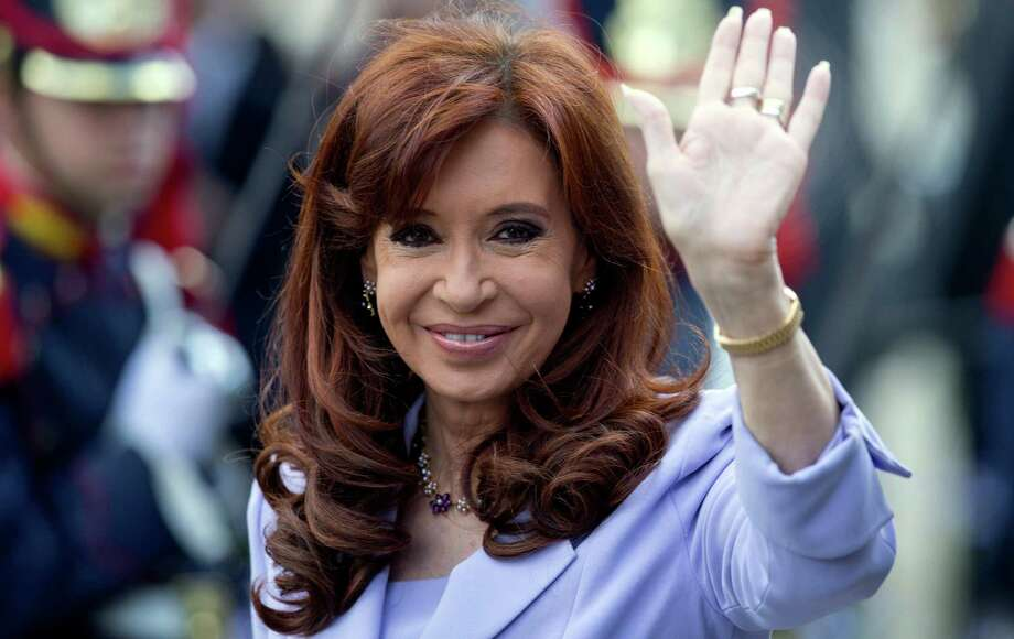 In this Dec. 17, 2014 photo, Argentina's President Cristina Fernandez waves to journalists during the Mercosur Summit in Parana, Argentina. Less than a year before presidential elections set for Oct. 2015, it's uncertain who'll succeed Fernandez. (AP Photo/Natacha Pisarenko) Photo: Natacha Pisarenko, STF / AP