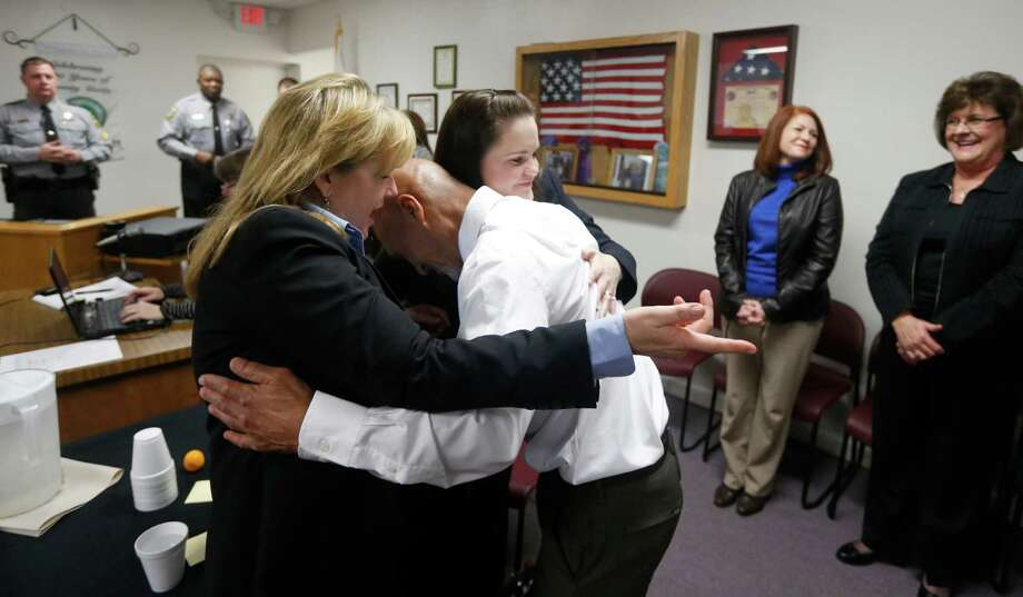 Christine Mumma, director of the North Carolina Center on Actual Innocence, left, and Cheryl Sullivan, staff attorney, hug Joseph Sledge after a special session of superior court in Whiteville, N.C. on Friday, Jan. 23,  2015. Sledge, 70, was freed from prison Friday, after a panel of judges found that he was wrongly convicted in the stabbing deaths of a mother and daughter nearly four decades ago. (AP Photo/The News & Observer, Ethan Hyman) Photo: Ethan Hyman, MBO / The News & Observer
