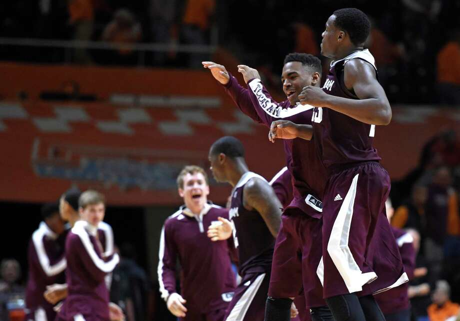 Texas A&M players celebrate after beating Tennessee 67-61 in an NCAA college basketball game at Thompson-Boling Arena in Knoxville, Tenn. on Saturday, Jan. 24, 2015. Texas A&M won 67-61. (AP Photo/Knoxville News Sentinel, Adam Lau)) Photo: ADAM LAU, Associated Press / Knoxville News Sentinel