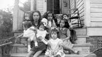 Photos, like this one from the 1940s, trace the Guillen family's life at 31 Saint Charles.