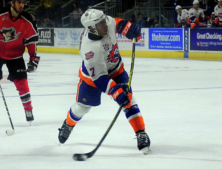 sound tigers scooter vaughan hits a slap shot during