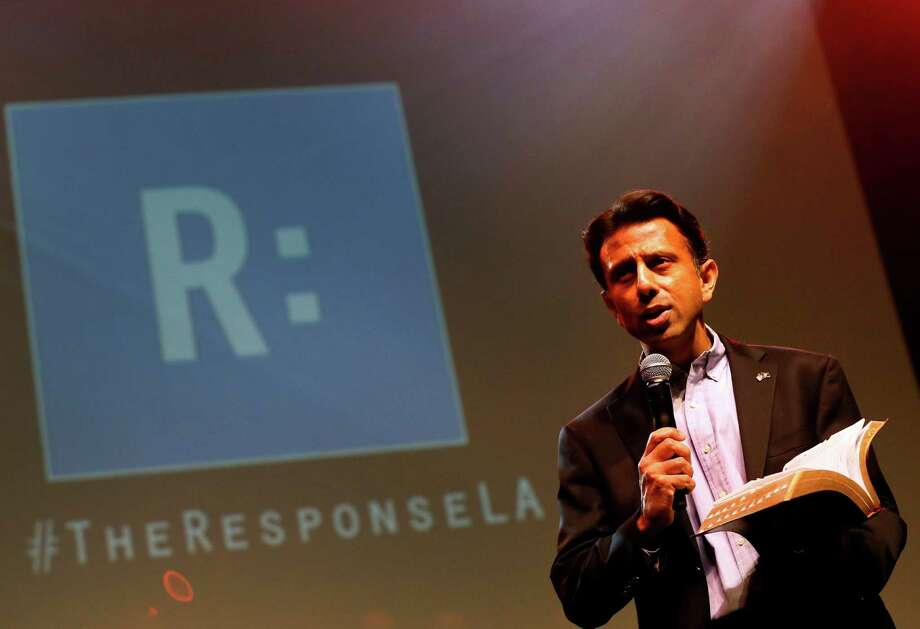 Louisiana Gov. Bobby Jindal reads from the bible during a prayer rally, Saturday, Jan. 24, 2015, in Baton Rouge, La. Jindal continued to court Christian conservatives for a possible presidential campaign with a headlining appearance at an all-day prayer rally hosted by the American Family Association. (AP Photo/Jonathan Bachman) Photo: Jonathan Bachman, FRE / FR170615 AP