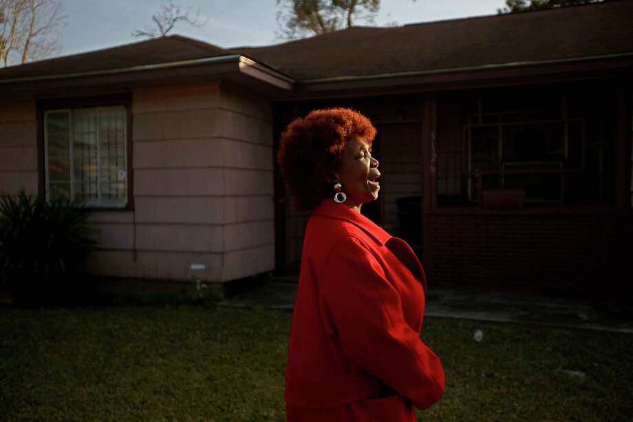 """""""Thank you God!"""" says Evelyn J. Pierce, 66, while she stands outside her home which will be torn down to build a new house with federal disaster money on Wednesday, Jan. 7, 2015, in Houston.  Pierce is one of several hundred people statewide who more than six years after the storm are still waiting for homes to be rebuilt or damage repaired with money earmarked for the purpose. Cities and counties were given millions of dollars for the program, but lacked experience and expertise in rebuilding on such a large scale. Photo: Mayra Beltran, Houston Chronicle / © 2015 Houston Chronicle"""