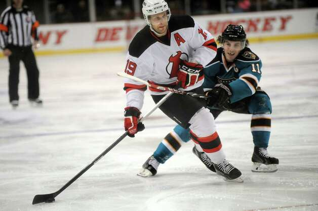 Devils' Mike Sislo, center, lines up a shot as Sharks' Bryan Lerg defends during their hockey game on Saturday, Jan. 24, 2015, at Times Union Center in Albany, N.Y. (Cindy Schultz / Times Union) Photo: Cindy Schultz / 00030124D