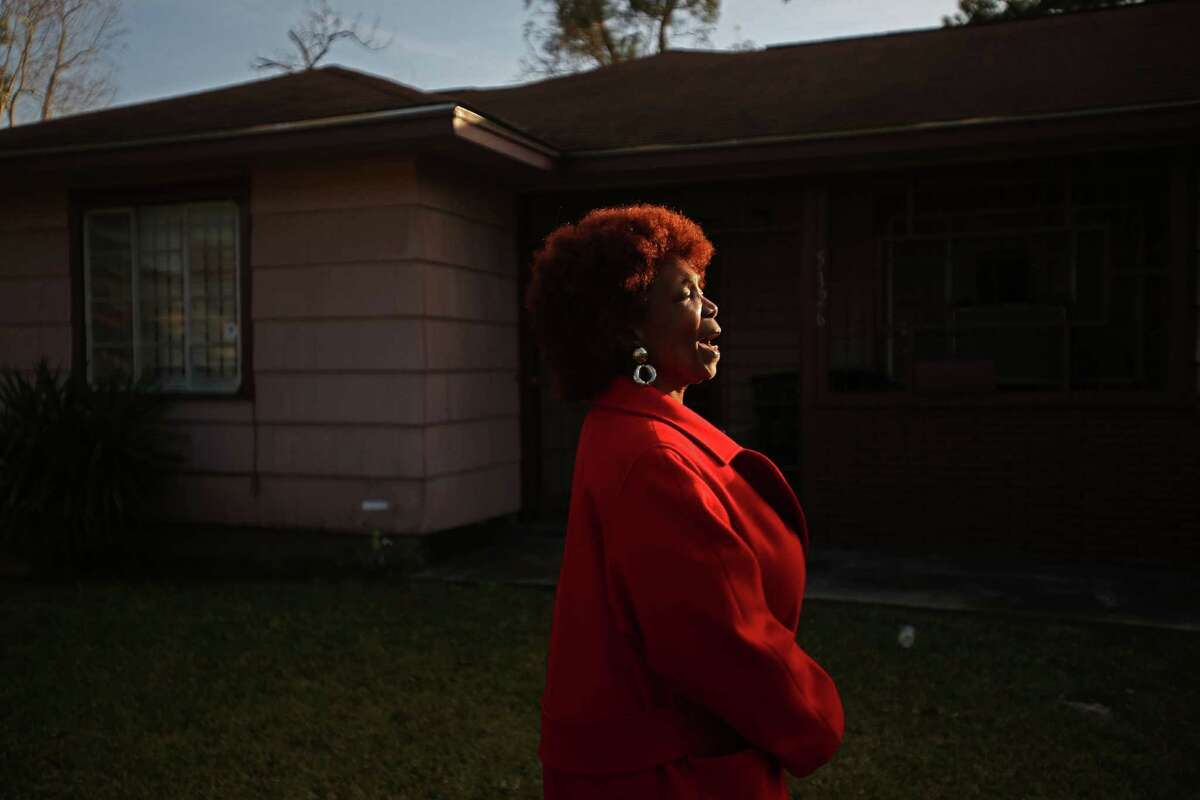 """""""Thank you God,"""" shouts Evelyn J. Pierce, 66, while she stands outside her home which will be torn down to build a new house."""