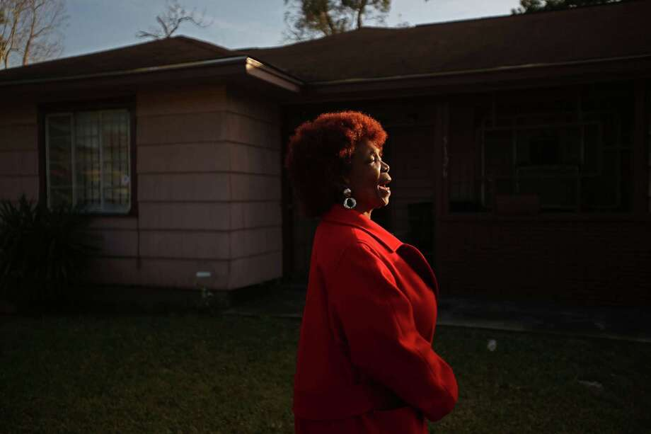 """Thank you God,"" shouts Evelyn J. Pierce, 66, while she stands outside her home which will be torn down to build a new house. Photo: Mayra Beltran, Staff / © 2015 Houston Chronicle"