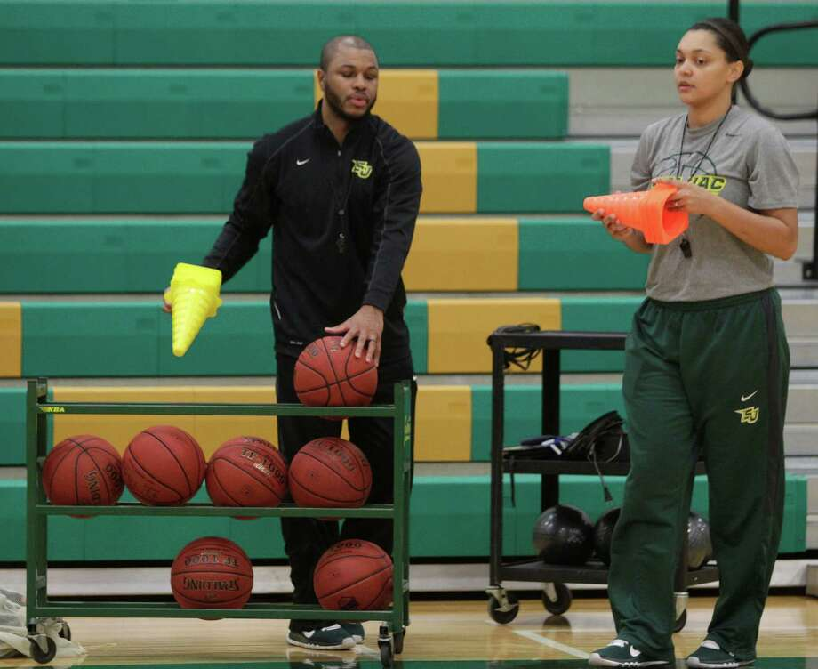 San Jacinto College women's basketball coach Brenita Jackson, right, and her husband and assistant coach, Kevin, try not to take their jobs home with them. Photo: Melissa Phillip, Staff / © 2014  Houston Chronicle