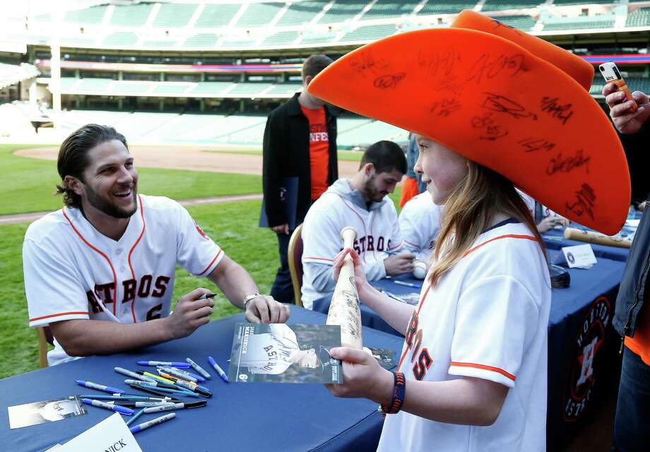 Freya Ross' foam Astros cowboy hat is a big hit with outfielder Jake Marisnick at Saturday's FanFest at Minute Maid Park. Freya, 11, was among a crowd of 5,000 who turned out for the franchise's annual meet-and-greet with players. Photo: Karen Warren, Staff / © 2015 Houston Chronicle