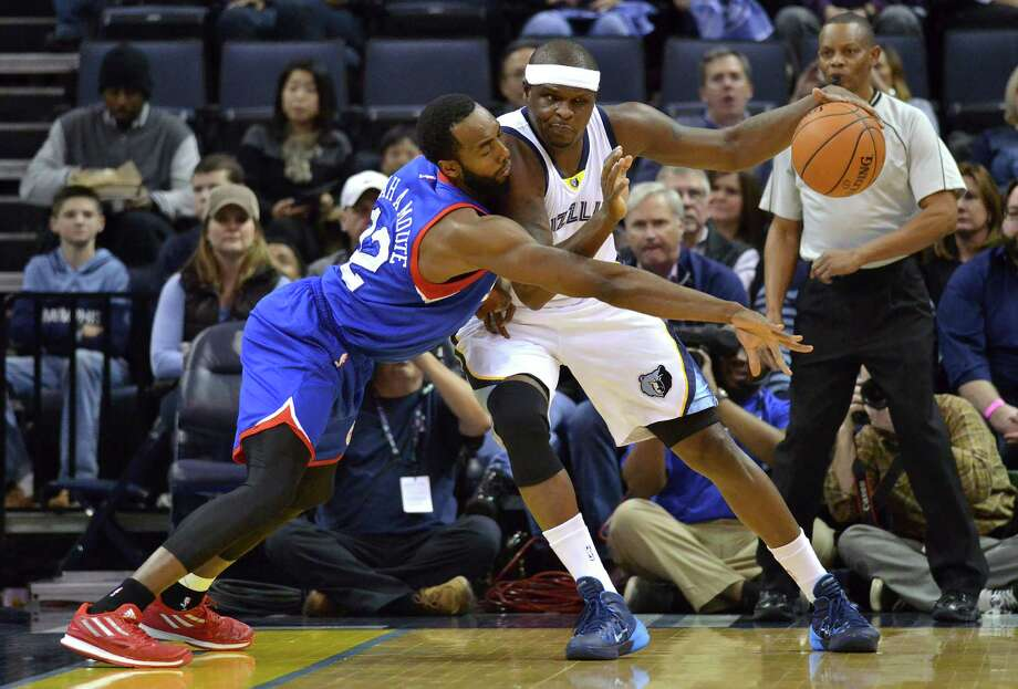 Despite pressure from 76ers forward Luc MbahaMoute, left, Memphis' Zach Randolph muscled his way to 17 points in the Grizzlies' win. Photo: Brandon Dill, FRE / FR171250 AP