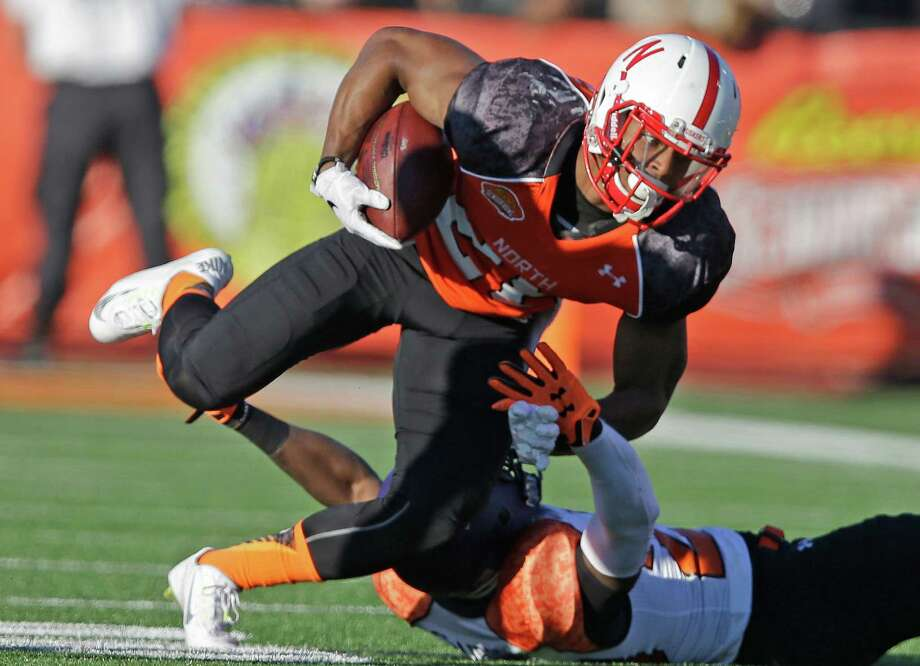 Nebraska running back Ameer Abdullah put on a good show for NFL scouts at the Senior Bowl, rushing for 73 yards and adding 40 more receiving. Photo: Brynn Anderson, STF / AP