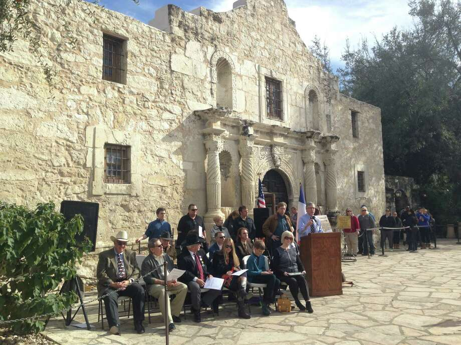 """Members of the San Jacinto Battleground Conservancy, descendants of participants in the battle of The Alamo and others participate in a dedication ceremony for a historic cannon at The Alamo shrine on Saturday, Jan. 24, 2015. The San Jacinto Battleground Conservancy hosted a dedication for the Alamo Defenders' cannon, which was bought by a family in an auction and donated in 2008 to the conservancy, which restored it and is loaning it to the Alamo.  It hasn't concretely been proven, but experts believe the cannon was one of the 21 used to defend the Alamo during the historic battle of 1836. It has the exact same damage as other Alamo cannons that have been definitively linked to the battle. A press release states, """"Both of the cannon's trunnions have been broken off and the fire hole is not spiked."""" The conservancy's Dr. Gregg Dimmick discussed the history of the cannon. Photo: Billy Calzada, San Antonio Express-News /  San Antonio Express-News"""