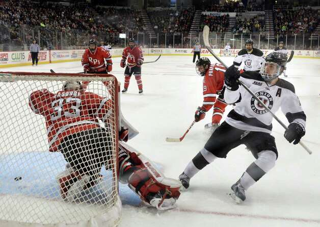 Union's #21 Mike Vecchione,right, scores against RPI goalie #33 Jason Kasdorf during Saturday's Mayor's Cup game at the Times Union Center Jan. 24, 2015, in Albany, NY.  (John Carl D'Annibale / Times Union) Photo: John Carl D'Annibale / 00030278A