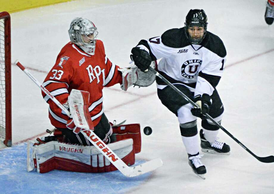Union's #17 Daniel Ciampini,right, looks for a way around RPI goalie #33 Jason Kasdorf during Saturday's Mayor's Cup game at the Times Union Center Jan. 24, 2015, in Albany, NY.  (John Carl D'Annibale / Times Union) Photo: John Carl D'Annibale / 00030278A