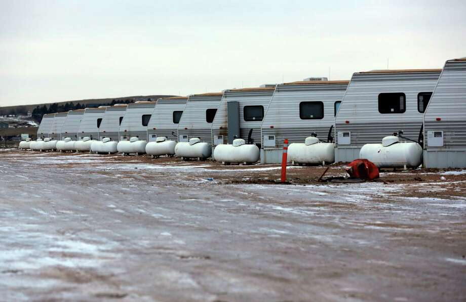 """Campers fill a row of housing at a """"man camp"""" near Watford City, N.D., part of the Bakken Shale. Photo: Photos By Eric Gay /Associated Press / AP"""