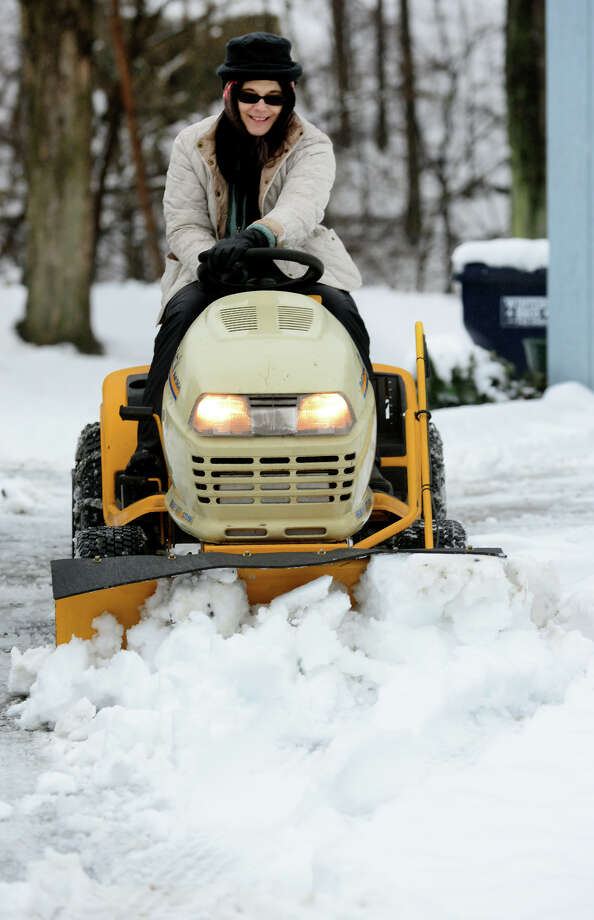 Donna Cherhoniak plows snow with her Cub Cadet plow at her home along Derby Avenue in Seymour, Conn. on Saturday Jan. 24, 2015. Cherhoniak said she got the plow on Craigslist with every attachment available and this was the first time she got to use it. Photo: Christian Abraham / Connecticut Post