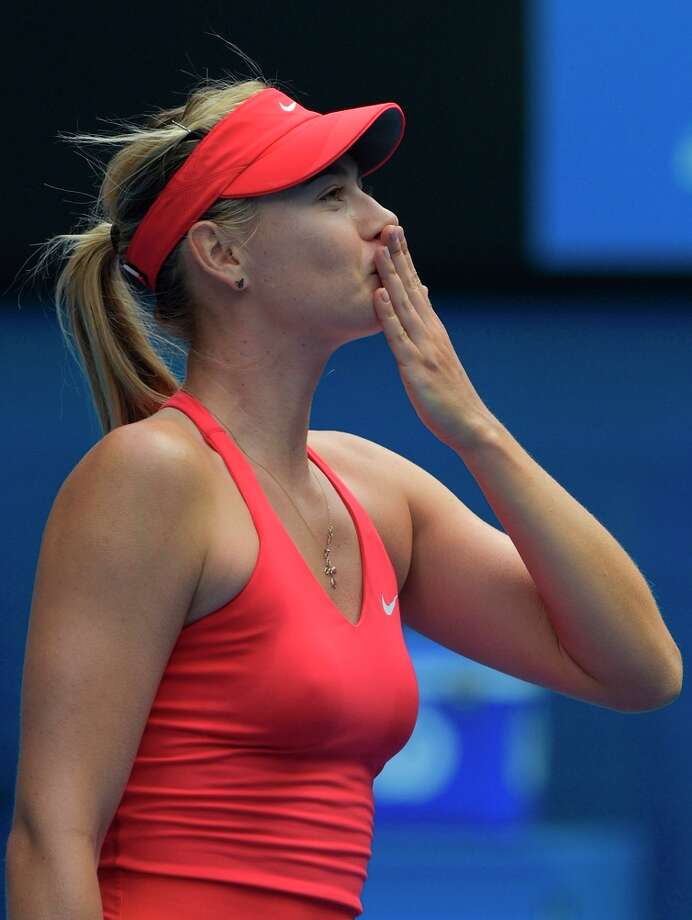 Maria Sharapova celebrates her fourth-round singles triumph over Peng Shuai on Sunday. Photo: GREG WOOD / AFP / Getty Images / AFP