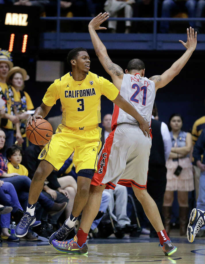 Cal's Tyrone Wallace tries to get past Arizona's Brandon Ashley during the first half on his way to 13 points. The Bears had a brief lead with 3:50 to play in the first half, but the spark didn't last. Photo: Ben Margot / Associated Press / AP
