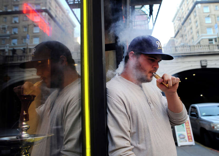 Store manager Sean Trataris smokes an e-cigarette outside Vapor Smoke Shop in downtown San Francisco. Photo: Michael Short / Special To The Chronicle / ONLINE_YES