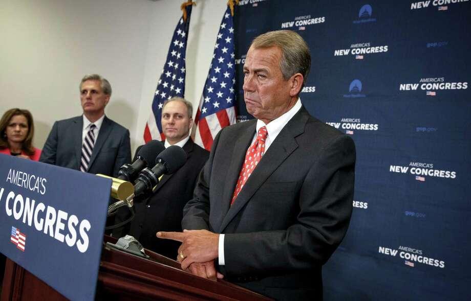 Republican House Speaker John Boehner of Ohio narrowly won the post after 20 conservatives voted against him. Photo: J. Scott Applewhite / Associated Press / AP