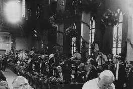 Archbishop Flores and Pope John Paul II pray at the altar at San Fernando Cathedral.