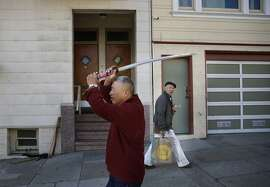 Stroke victim and student of the Japanese martial art know as aikido, Tim Sum, 70, shows off his ceremonial sword near his apartment in San Francisco, Calif. on Monday January 19, 2015 in Alameda, Calif.