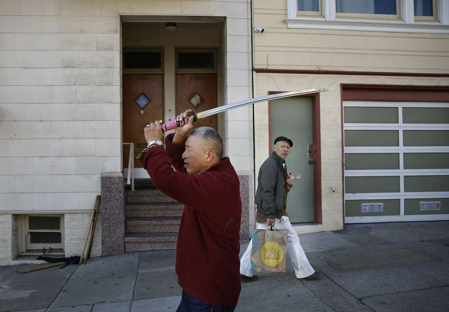 Stroke victim and student of the Japanese martial art know as aikido, Tim Sum, 70, shows off his ceremonial sword near his apartment in San Francisco, Calif. on Monday January 19, 2015 in Alameda, Calif. Photo: Mike Kepka, The Chronicle