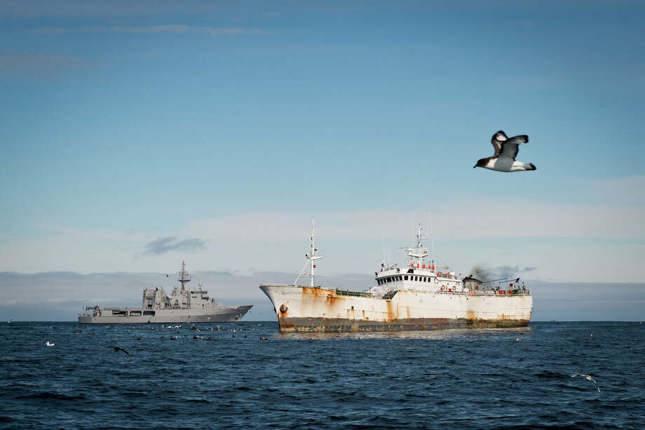 "This Jan. 14, 2015 photo provided by the Royal New Zealand Navy shows the illegal fishing boat  the ""Kunlun."" foreground,  in the Southern Ocean off the coast of New Zealand. According to the Interpol summary, the Kunlun is owned by a shell company in Panama. It has been called the Black Moon, the Galaxy and the Chang Bai, among other names, and has been registered in North Korea, Sierra Leone, Tanzania, Panama, Indonesia and Equatorial Guinea. Photo: Amanda McErlich, AP / RNZN"