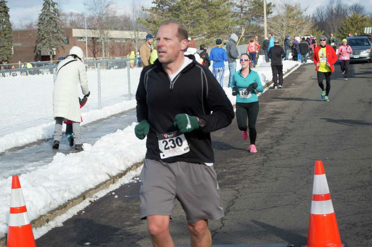 The Milford Road Runners' Winter Wonderland 5 Miler was held on January 25, 2015 at Platt Regional Tech School in Milford. Proceeds from the race went to college scholarships given out by the Milford Road Runners, a kids summer track series and other community donations. Were you SEEN?
