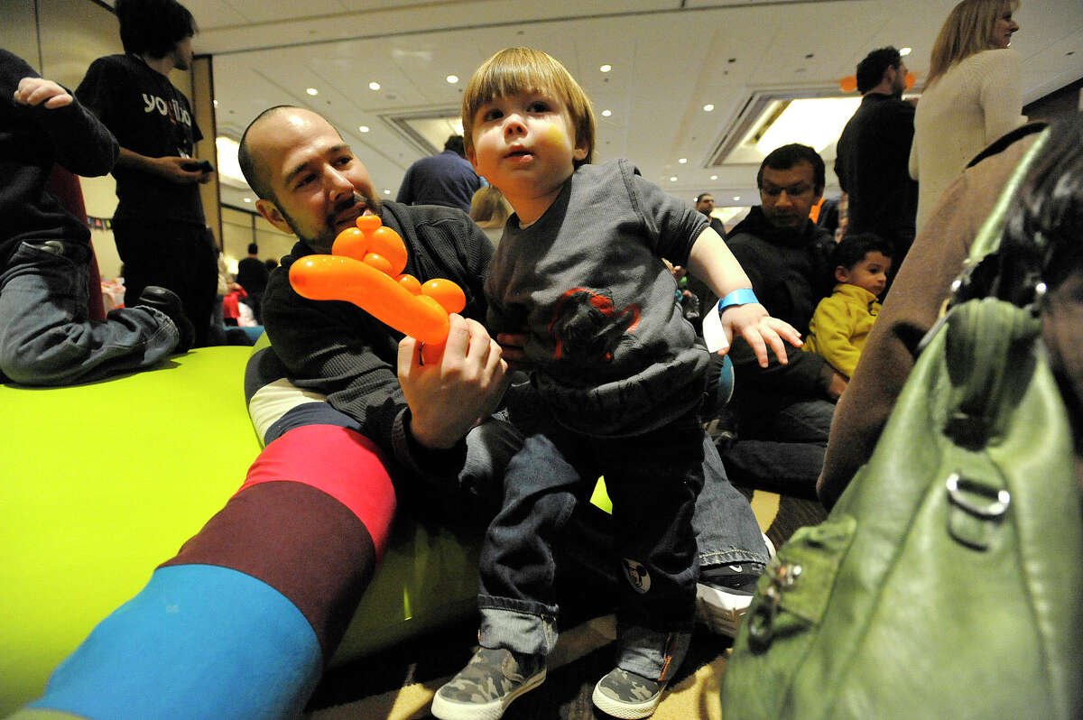 Jason Michaels and his two-year-old son Sean play around while listening to a live band perform during the Celebrity Baby Trends' family fun day at the Hyatt Regency in Greenwich, Conn., on Sunday, Jan. 25, 2015. The event featured games, entertainment and vendors catering to young families and expectant parents.