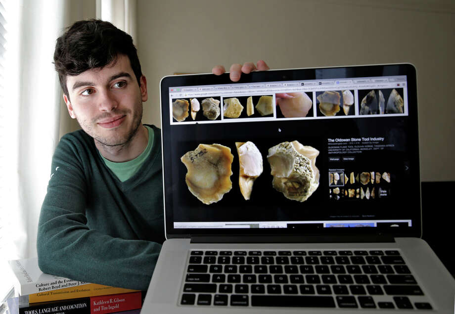 UC Berkeley scientist Thomas Morgan shows images of stone tools made by our ancestors more than a million years ago. Photo: Michael Macor / The Chronicle / ONLINE_YES