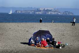 Several families employed tents for their visit to East Beach. Thousands flocked to San Francisco beaches Sunday January 25, 2015. At East Beach near Crissy Field many admitted it was colder than weather reports indicated.
