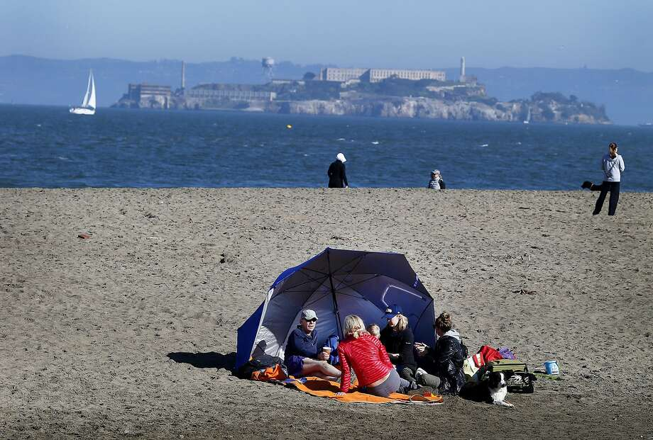 Several families employed tents for their visit to East Beach. Thousands flocked to San Francisco beaches Sunday January 25, 2015. At East Beach near Crissy Field many admitted it was colder than weather reports indicated. Photo: Brant Ward, The Chronicle