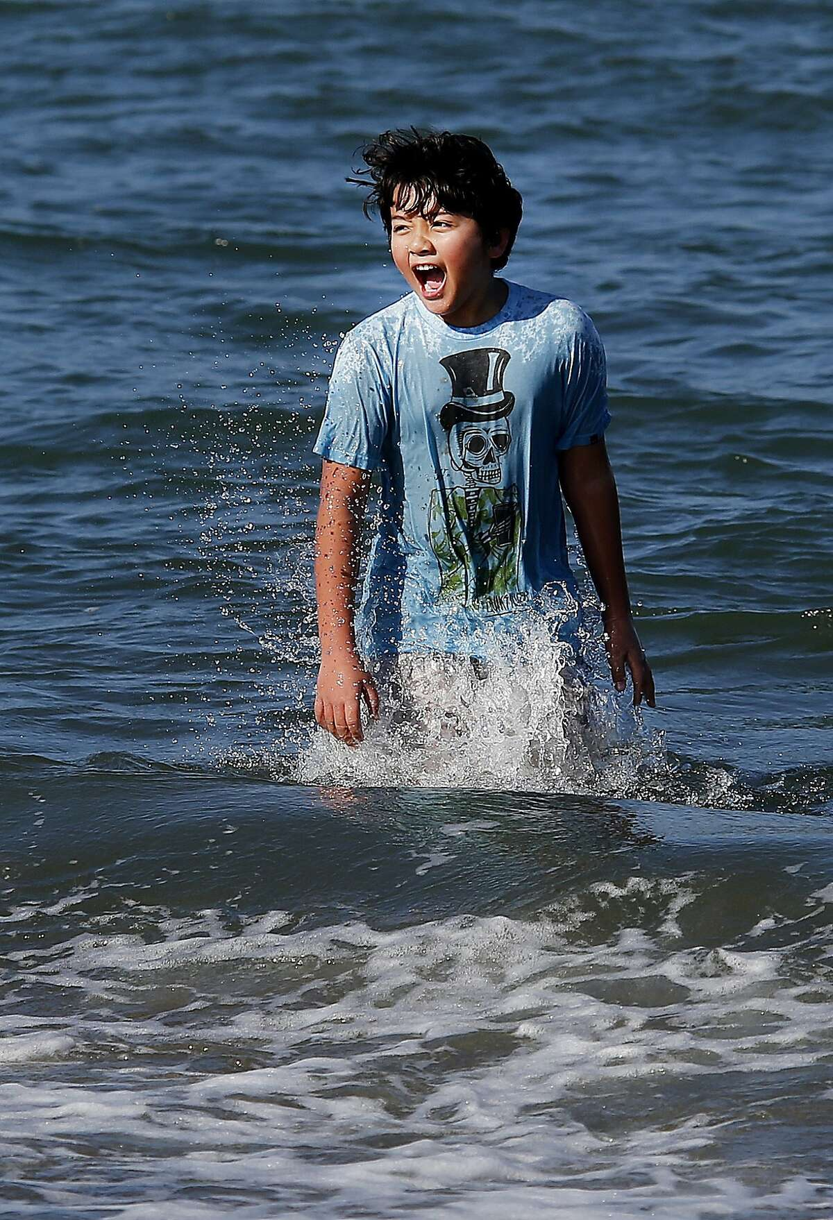 Ten year old Lance Hughston got into the high surf at East Beach despite a chilly wind. Thousands flocked to San Francisco beaches Sunday January 25, 2015. At East Beach near Crissy Field many admitted it was colder than weather reports indicated.