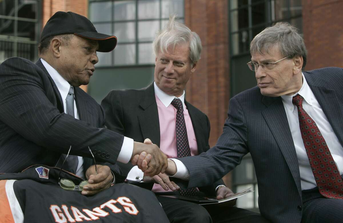 Baseball Commissioner Bud Selig, right, shakes hands with former Giant Willie Mays, with Peter Magowan looking on, after the 2007 All-Star Game announcement.