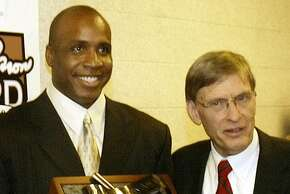 ** FILE ** San Francisco Giants' Barry Bonds, left, holds the National League Hank Aaron award with Commissioner Bud Selig, right, during a ceremony before Game 4 of the World Series in this Oct. 27, 2004 photo in St. Louis.  (AP Photo/James Finley)Ran on: 03-11-2006 Commissioner Bud Selig (right) appears to be evaluating his options in dealing with allegations about Barry Bonds' steroid use.Ran on: 03-11-2006 Commissioner Bud Selig (right) appears to be evaluating his options in dealing with allegations about Barry Bonds' steroid use.Ran on: 03-11-2006 Commissioner Bud Selig (right) appears to be evaluating his options in dealing with allegations about Barry Bonds' steroid use.
