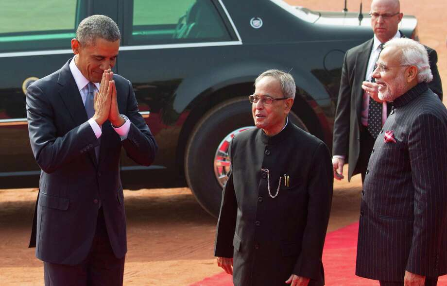 President Obama makes a traditional Indian greeting gesture as Indian President Pranab Mukherjee (center) and Prime Minister Narendra Modi welcome him to the presidential palace in New Delhi. Photo: Saurabh Das / Associated Press / AP