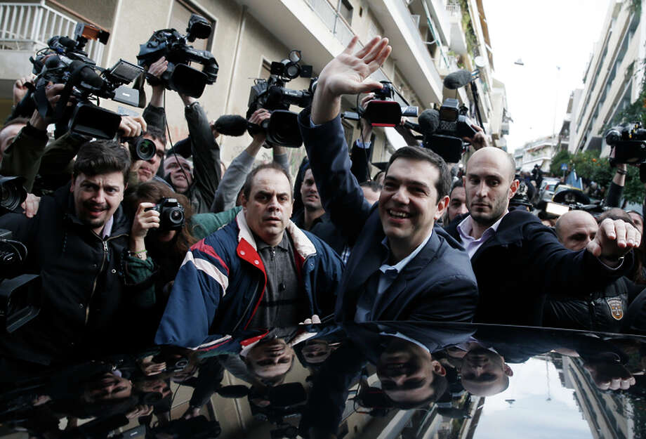 Alexis Tsipras, leader of Greece's Syriza left-wing opposition, waves to backers after voting in Athens. Photo: Petros Giannakouris / Associated Press / AP