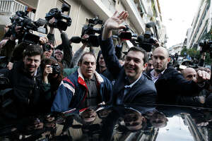 Joy, nervousness in Greece after leftists' parliamentary win - Photo