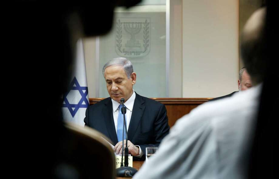 """Israeli Prime Minister Benjamin Netanyahu attends the weekly cabinet meeting in his Jerusalem office, Sunday, Jan. 25, 2015.  Israel's premier says he will go """"anywhere"""" he is invited to speak about the country's stance regarding Iran's nuclear program. (AP Photo/Baz Ratner, Pool) Photo: Baz Ratner / Associated Press / Reuters Pool"""