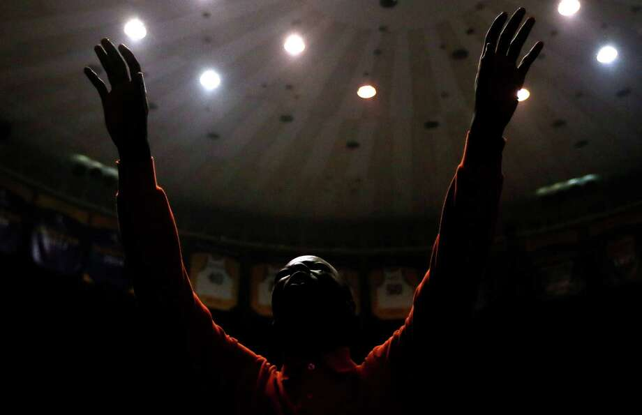 Justin Spence prays at a rally hosted by the American Family Association and headlined by Louisiana Gov. Bobby Jindal on Saturday in Baton Rouge, La. Photo: Jonathan Bachman / Associated Press / FR170615 AP