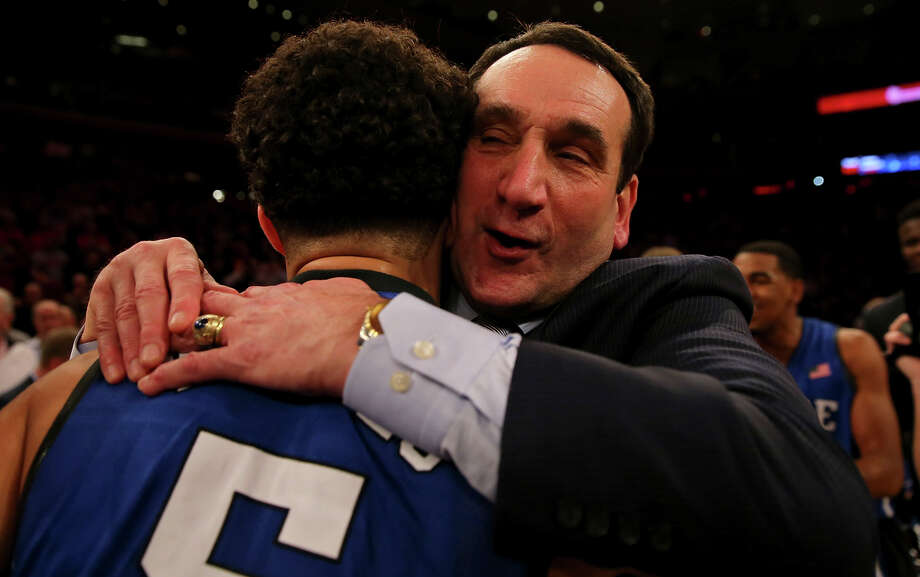 Basking in his milestone moment, Mike Krzyzewski hugs Duke's Tyus Jones. Photo: Elsa / Getty Images / 2015 Getty Images