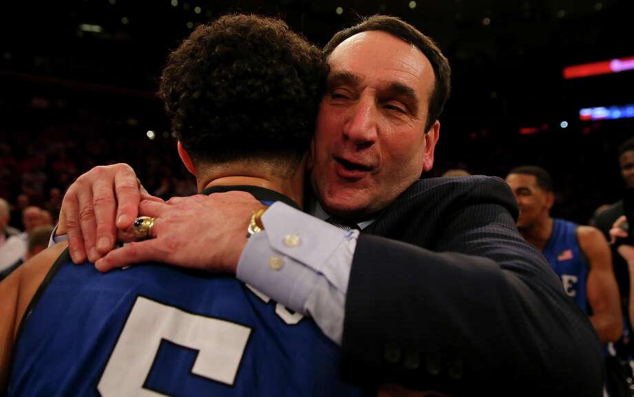 Basking in his milestone moment, Mike Krzyzewski hugs Duke's Tyus Jones. Photo: Elsa / Getty Images / 2015 Getty Images