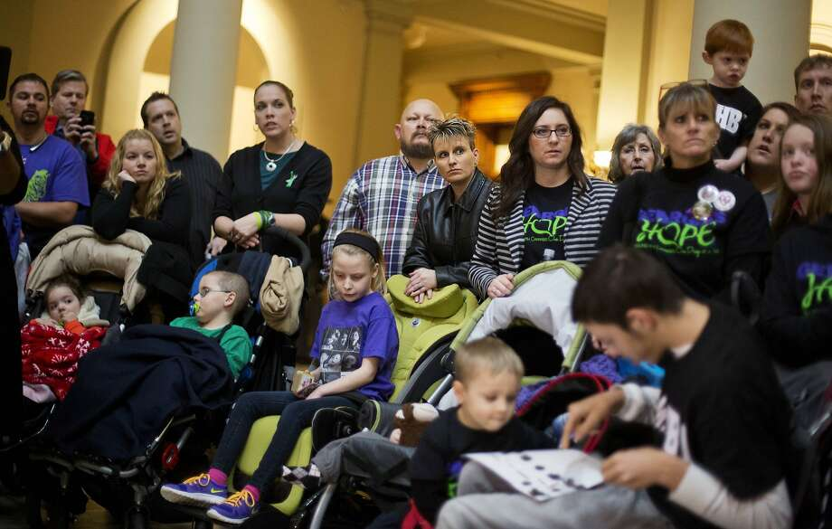 FILE- In this Jan. 13, 2015 file photo, parents of children who suffer from epilepsy attend a press conference on House Bill 1 at the state Capitol in Atlanta. A Georgia lawmaker plans to file a bill legalizing possession of cannabis oil for treatment of certain illnesses. State Rep. Allen Peake, a Republican from Macon, says the bill was developed with Gov. Nathan Deal, who objected to earlier discussion of producing and selling the oil in-state. Photo: David Goldman, Associated Press