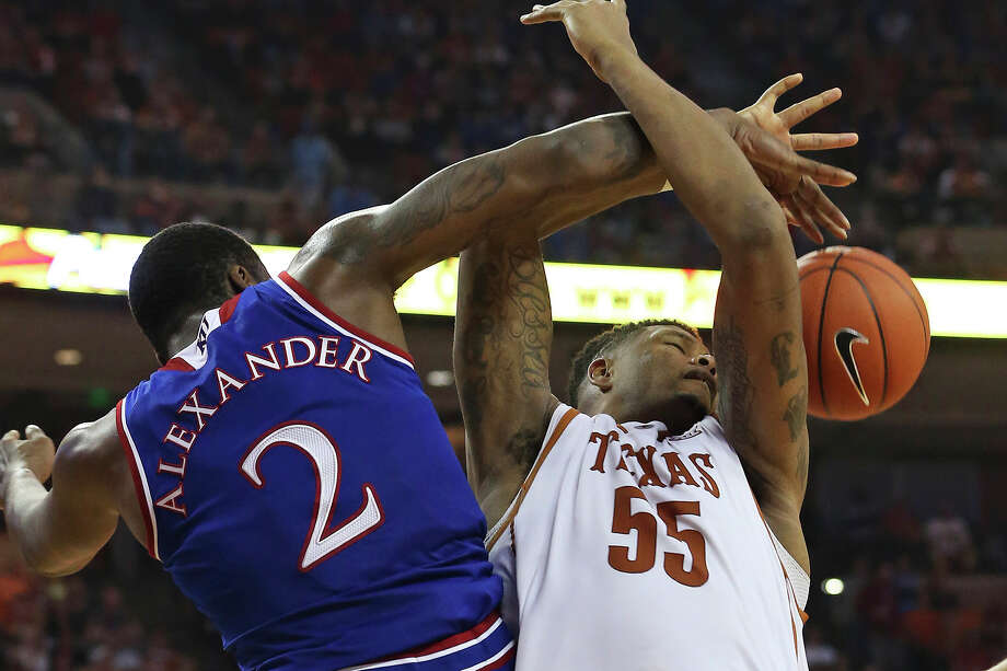 Longhorn center Cameron Ridley gets his shot rejected by Cliff Alexander in the second half as Texas hosts Kansas at the Erwin Center. Kansas beat Texas, 75-62. The loss drops the Longhorns to 3-3 in Big 12 play. Photo: Tom Reel /San Antonio Express-News