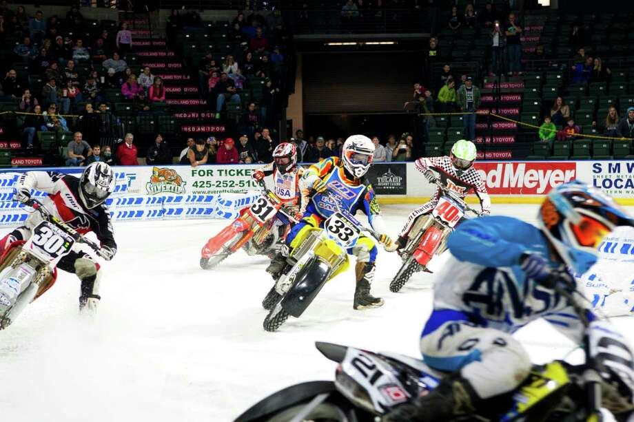 Local and international riders took to the ice to race their motorcycles, quads, three-wheelers, and go-karts at the X-treme International Ice Racing competition on Saturday, January 24, 2015 at the Xfinity Arena in Everett, Wash. Photo: ANNA ERICKSON, SEATTLEPI.COM / SEATTLEPI.COM