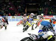 Local and international riders took to the ice to race their motorcycles, quads, three-wheelers, and go-karts at the X-treme International Ice Racing competition on Saturday, January 24, 2015 at the Xfinity Arena in Everett, WA.