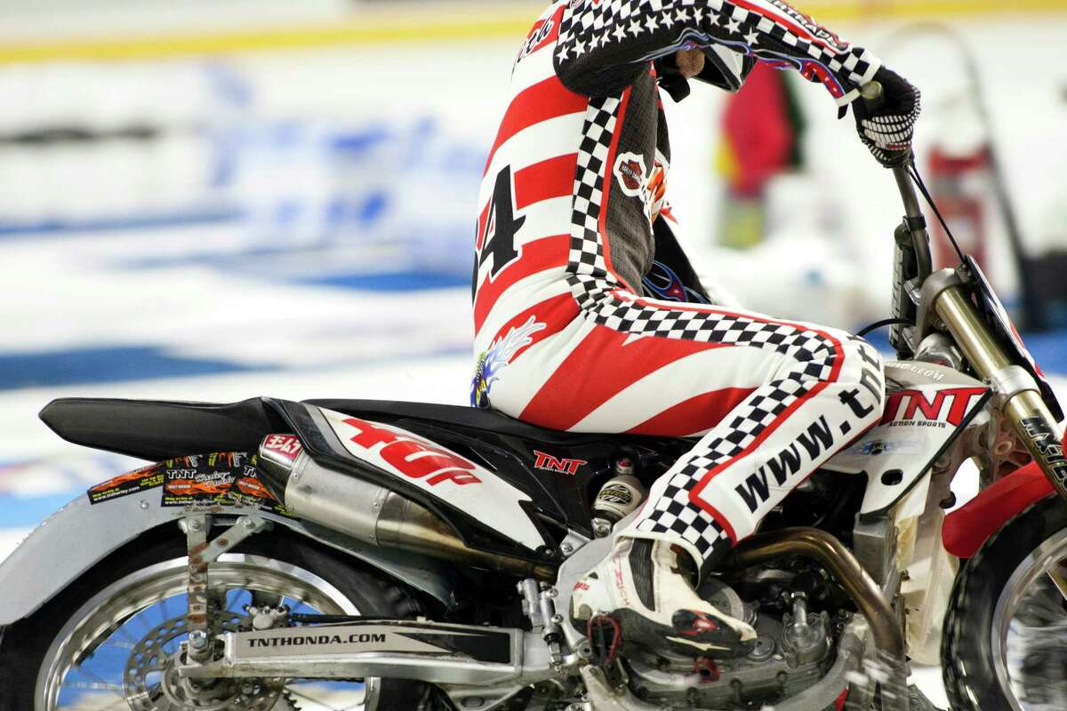Local and international riders took to the ice to race their motorcycles, quads, three-wheelers, and go-karts at the X-treme International Ice Racing competition on Saturday, January 24, 2015 at the Xfinity Arena in Everett, Wash.